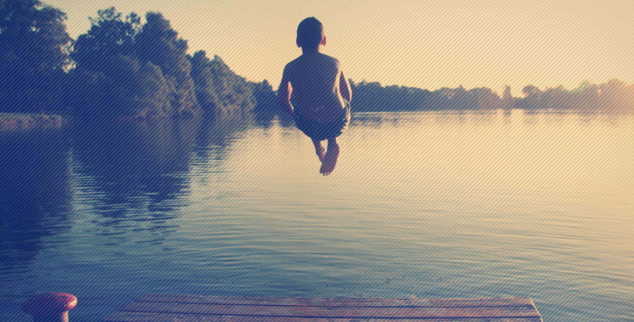 Boy Jumping In A Lake